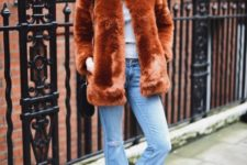 With shirt, fur jacket and black boots