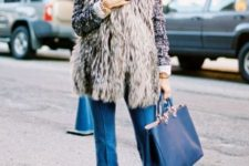 With shirt, fur vest and navy blue tote