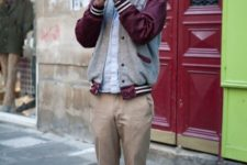 With shirt, varsity jacket and brown shoes