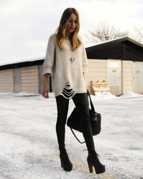 With skinny leather pants, white sweater and bag