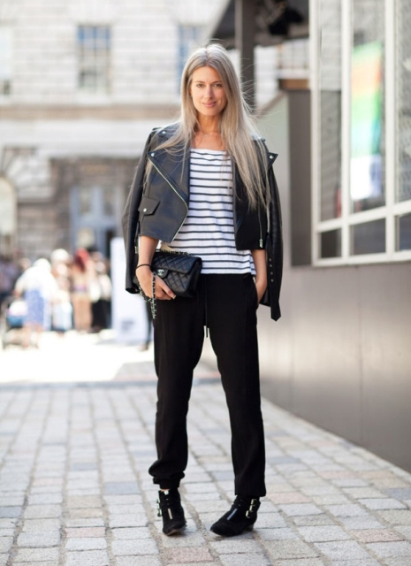 With striped shirt, black leather jacket, black boots and clutch