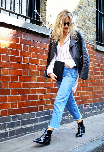 With striped shirt, black leather jacket, black clutch and crop jeans