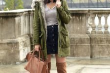 With striped shirt, black mini skirt, high boots and brown bag