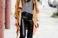 With striped shirt, camel trench coat, beanie and platform boots