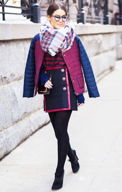 With striped shirt, unique skirt, ankle boots and two color puffer jacket