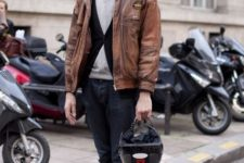 With sweater, brown leather jacket and red shoes