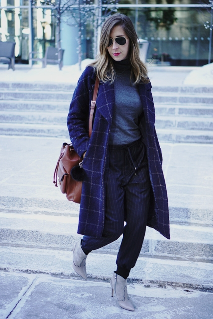 With turtleneck, gray ankle boots, checked coat and brown bag