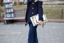 With turtleneck, navy blue jacket and white clutch