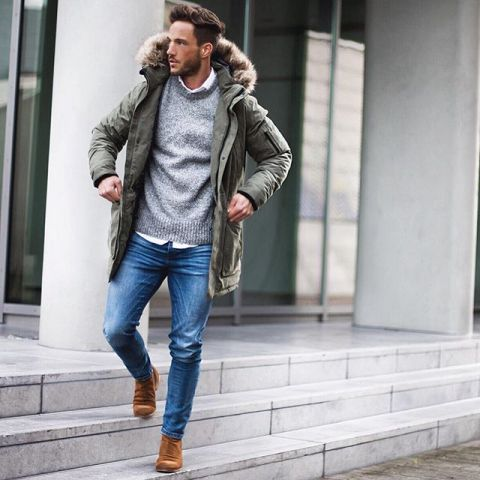 With white button down shirt, gray sweater, straight jeans and brown boots