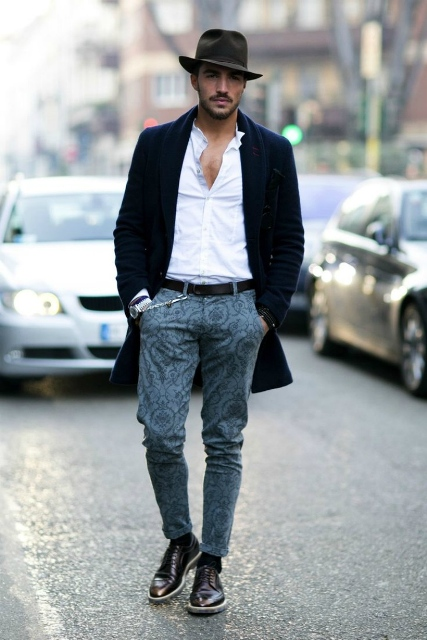With white button down shirt, printed pants, black shoes and coat