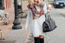 With white dress, black high boots, black beanie and leather bag