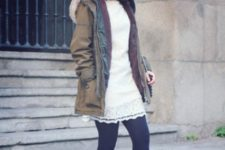 With white dress, black tights and ankle boots