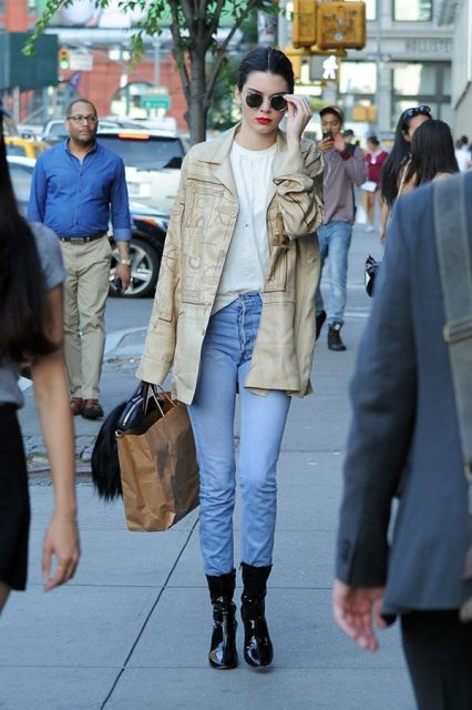 With white loose shirt, straight jeans and beige parka