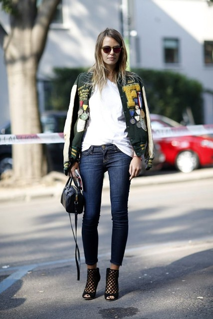 With white shirt, crop jeans, cutout boots and small bag