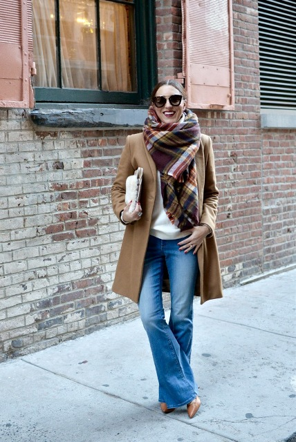 With white shirt, plaid scarf, camel coat and clutch