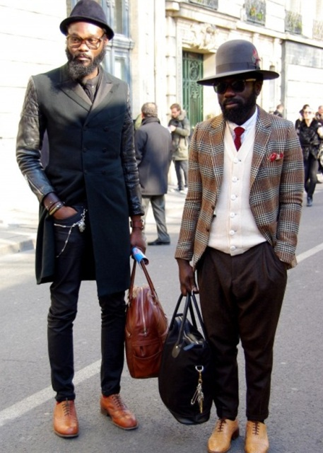With white shirt, red tie, white sweater, printed blazer, brown trousers, camel boots and big bag