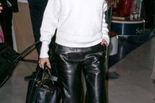 With white sweater, black pumps and black bag