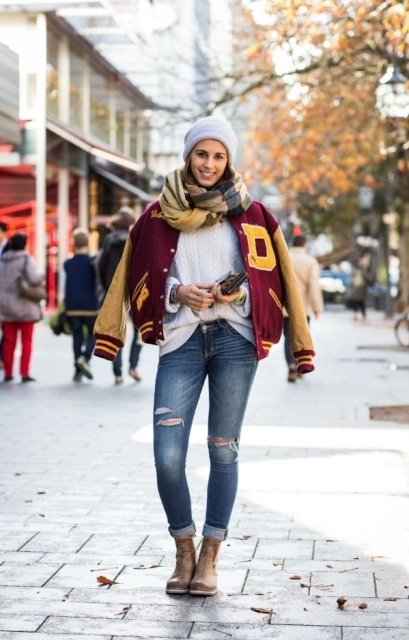 With white sweater, distressed jeans, brown ankle boots, beanie and plaid scarf