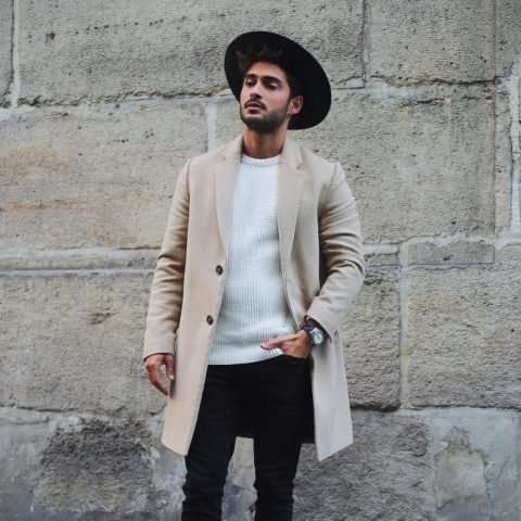 With white sweatshirt, black pants and beige coat