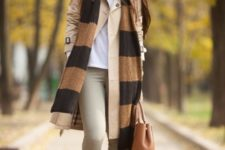 With white t-shirt, beige coat, light gray pants, brown leather tote and printed scarf