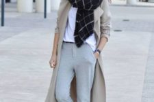 With white t-shirt, checked scarf, beige trench coat and sneakers