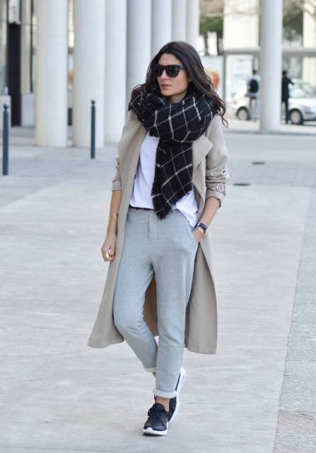 With white t shirt, checked scarf, beige trench coat and sneakers