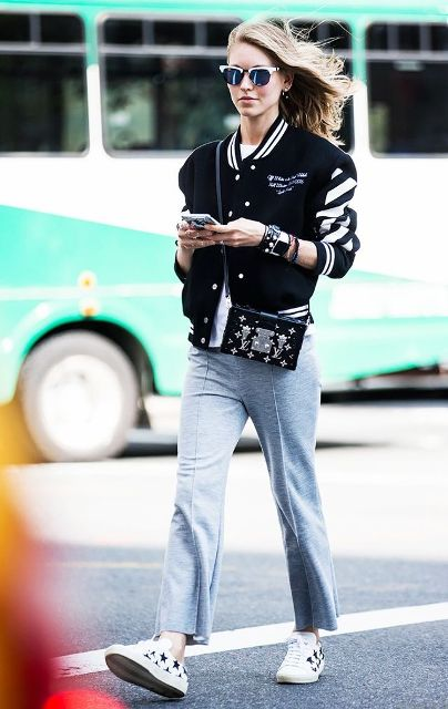 With white t-shirt, gray pants, printed sneakers and embellished bag