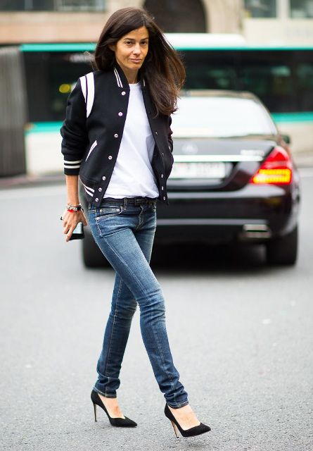 With white t-shirt, skinny jeans and black high heels