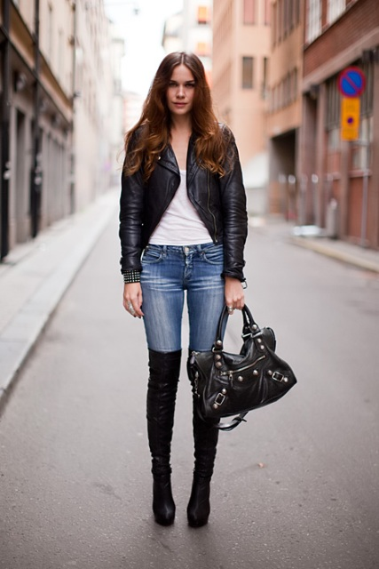 With white top, jeans, leather jacket and leather bag