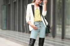 With yellow blouse, skinny jeans, black and white jacket and mini bag