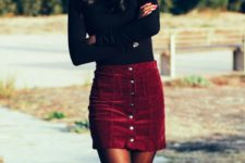 02 a black long sleeve top, a burgundy velvet mini skirt with a row of buttons and black suede tall boots