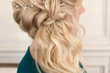 02 a braided side half updo with waves and a small hairpiece looks chic and cute