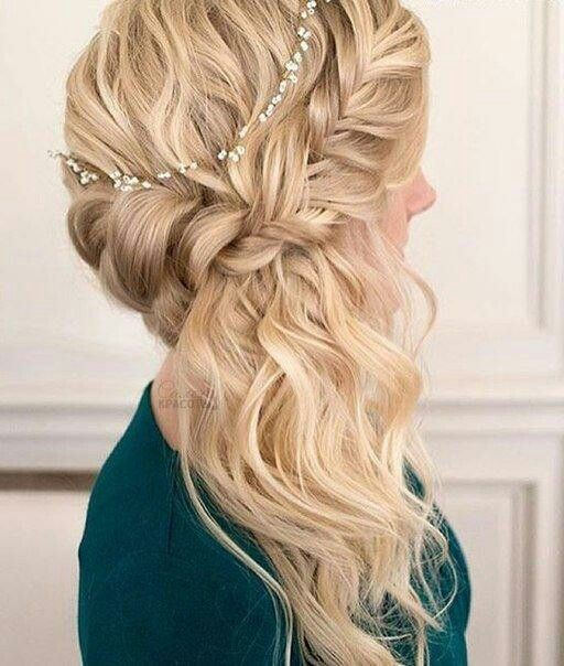 a braided side half updo with waves and a small hairpiece looks chic and cute