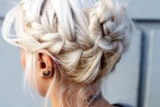 02 a classic messy braided updo with a bun and bangs hanging