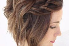 02 angled short haircut with waves and a double braid on one side