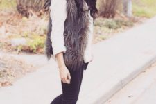 02 black jeans, amber boots, a white shirt, a brown faux fur vest and a beanie