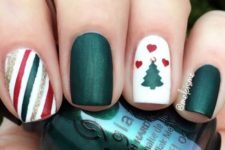 02 dark green, white, red and gold nails with a striped one and a tree one