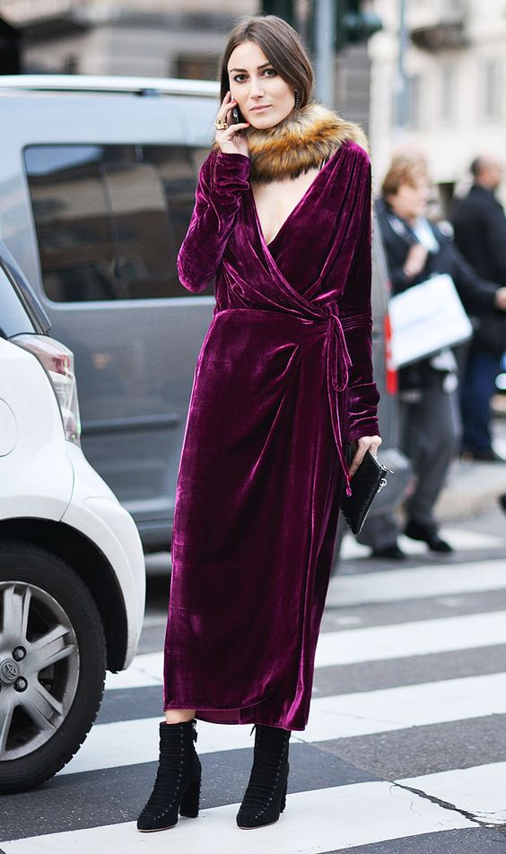 a fuchsia wrap dress with a V neckline, a faux fur scarf and black suede boots