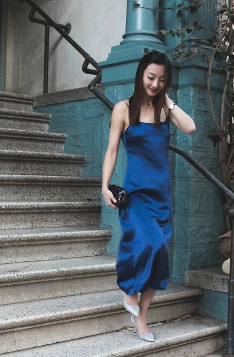 a navy slip silk dress, sparkling silver shoes and an elegant clutch