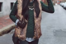 03 black skinnies, a shirt, a green sweater, a faux fur vest and knee boots