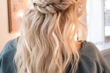 04 a double braided half updo with waves looks effortlessly chic