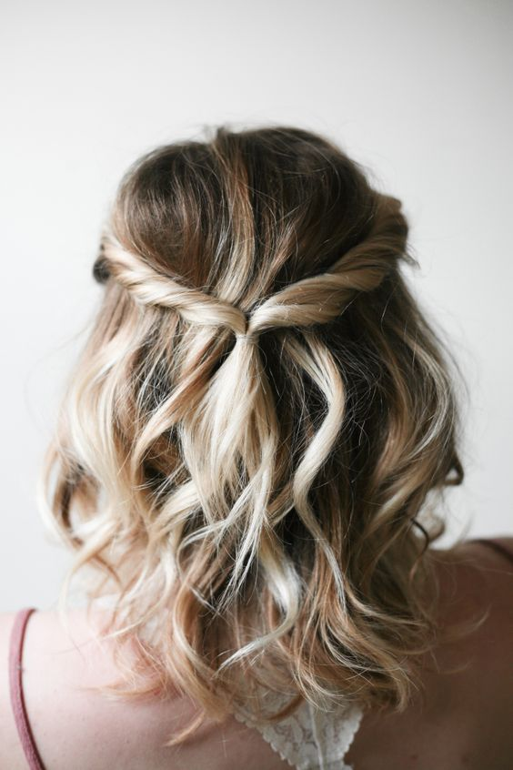 a twisted wavy half updo is an effortlessly chic idea