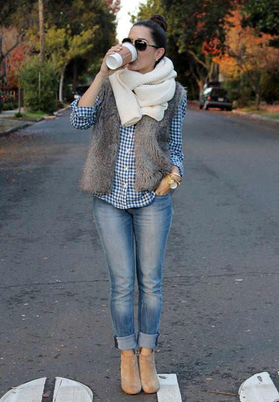 blue jeans, a plaid shirt, a brown faux fur vest, beige booties and a scarf