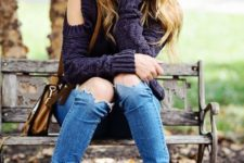 04 blue ripped jeans, a deep purple cable knit sweater with a cold shoulder and greey sneakers