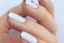 04 white nails with a gold rim is a fresh take with a metallic shade