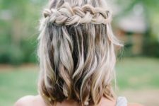 05 a messy half updo with a large braid and balayage is a chic idea