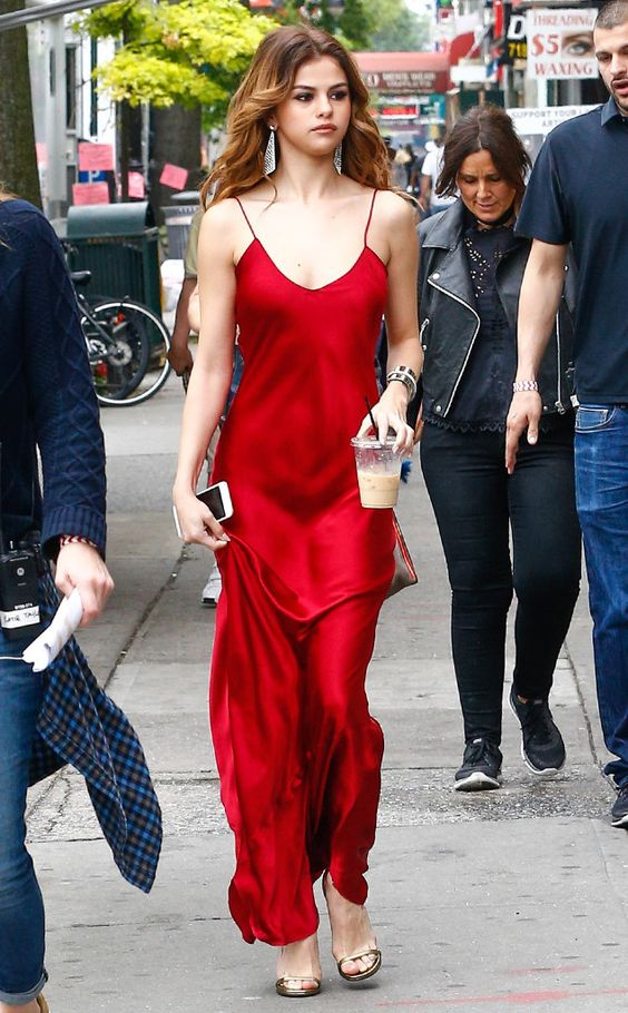 a red slip maxi dress, a pair of statement earrings and metallic shoes for a gorgeous look