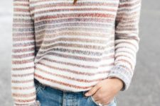 05 blue jeans and a striped cutout sweater for a cozy and cute look