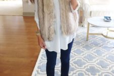 05 navy skinnies, a white shirt, a neutral faux fur vest and brown booties