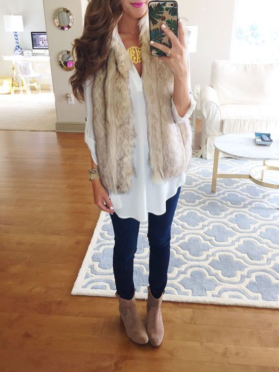 navy skinnies, a white shirt, a neutral faux fur vest and brown booties